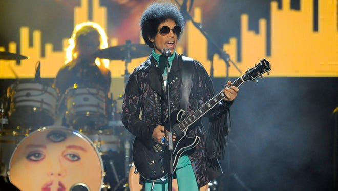 Prince performs at the Billboard Music Awards at the MGM Grand Garden Arena in Las Vegas, in May 2013.