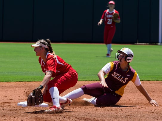 Bells' Bella Smith slides in to second base during the first inning of their 2A state semifinal game against Albany. Bells won the game, 13-0, to advance to the final against Normangee.