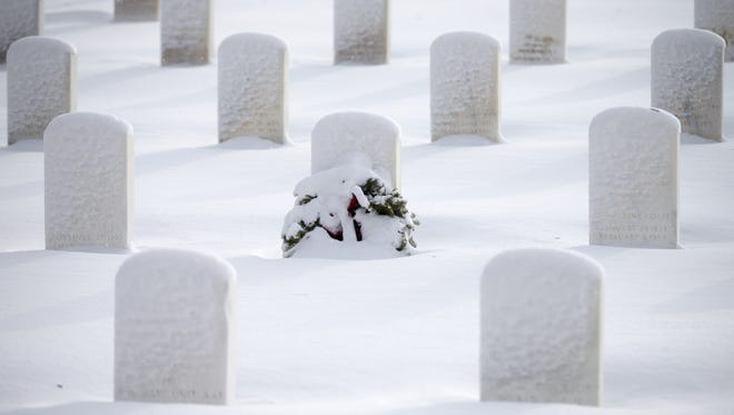 Headstones at Blue Star Memorial, an area for U.S. Armed Forces at Crown Hill Cemetery in 2016,