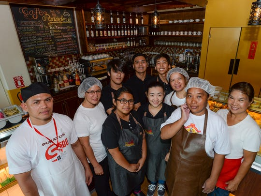 The Cafe Panadero and New Fresh Bread Bakeshop staff take a group photo at Cafe Panadero in Yigo on Feb. 25, 2016.