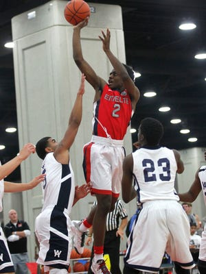 Antonio Blakeney (2) battles pressure from Jerry Ruffin (2) and Cortez McCree (23) during their game at the AAU basketball Championship at the Fairgrounds in Louisville, Kentucky.       July 24, 2014