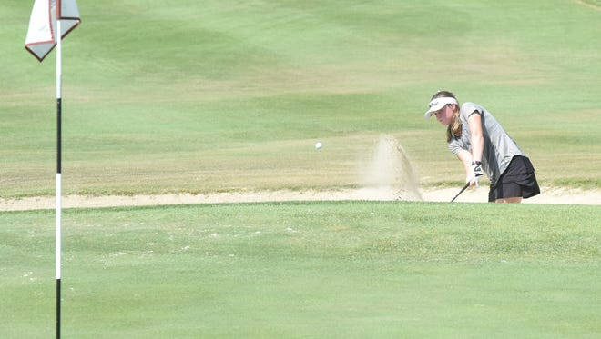 In this file photo, Mountain Home's Kenzie Collins hits out of the 18th bunker at Big Creek Golf & Country Club. Collins shot an 84 to earn medalist honors in the Lady Bombers' victory over Searcy on Wednesday.