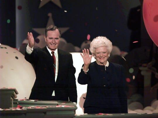 President George H.W. Bush and first lady Barbara wave