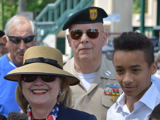 Hillary Clinton, with Jim McCauley, center, grand marshal of the New Castle Memorial Day parade, in downtown Chappaqua for the 2014 ceremonies.