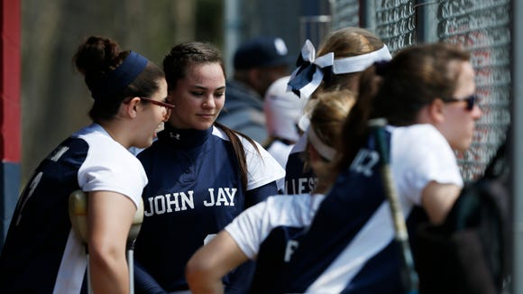 John Jay's Meg Schumacher talks with her teammates