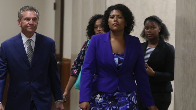 Rochester City Court Judge Leticia D. Astacio in August enters court with her attorney Ed Fiandach to find out the verdict in her bench trial in August. She was found guilty of driving while intoxicated.