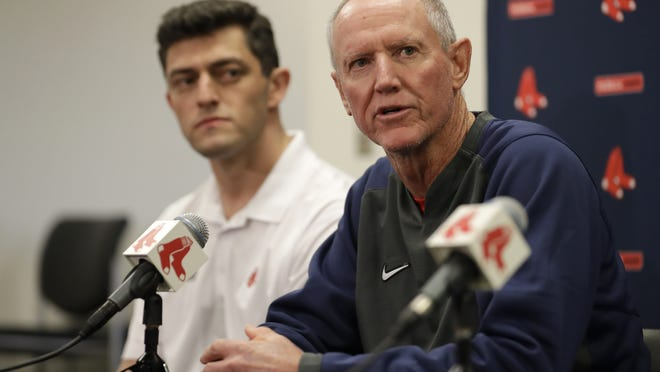 Ron Roenicke (right) speaks as Red Sox Chief Baseball Officer Chaim Bloom looks on after being after being named interim manager of the Boston Red Sox on Feb. 11, 2020, in Fort Myers, Fla. On Sunday, Bloom released the Red Sox' 40-man roster for when Major League Baseball is set to return next month.