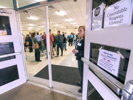 Poll manager Jill Burroughs stands by the open doors at McCants Middle School polling place on Tuesday. Nearly 100 were in line at 7 a.m. and 150 voted in the first hour at the precinct.