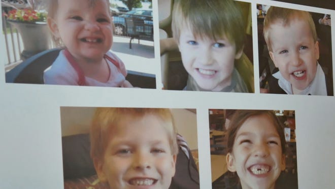Photos of Timothy Ray Jones Jr. children are on display during a news conference at the Lexington County Sheriff's Dept Training Center in Lexington, S.C., Wednesday, Sept. 10, 2014.  Jones Jr., 32, will be charged with murder in the deaths of his five children after he led authorities to a secluded clearing in Alabama, where their bodies were found wrapped in garbage bags, a sheriff said Wednesday.