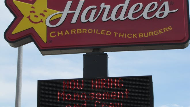 Hardee's sign advertises need for staff.