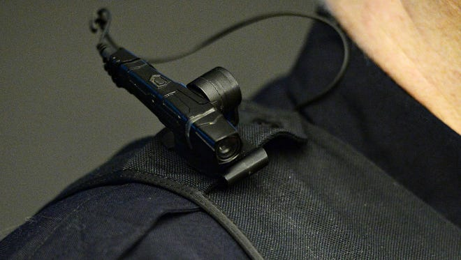 Sgt. Dean Cunningham models a body camera worn by Fort Collins police officers at Fort Collins Police Services on Friday, January 13, 2016.