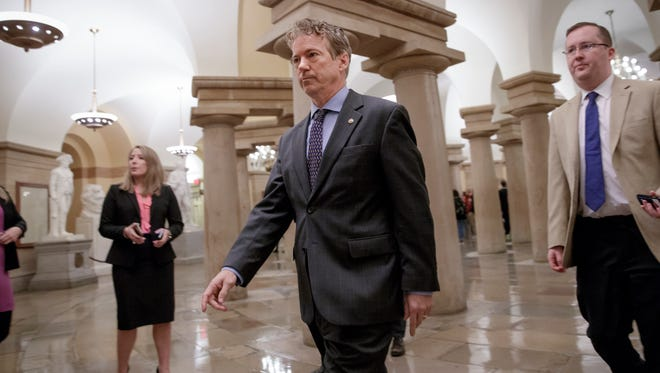 Sen. Rand Paul walks to a room on Capitol Hill on March 2, 2017, where he charges House Republicans are keeping their Obamacare repeal and replace legislation under lock and key and not available for public view.