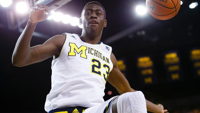 Michigan Wolverines guard Caris LeVert dunks in the first half against the Minnesota Golden Gophers at the Crisler Center.