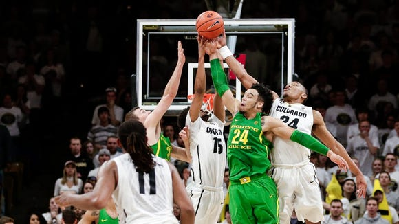 Jan 28, 2017; Boulder, CO, USA; Colorado Buffaloes guard Xavier Johnson (11) looks on as guard Dominique Collier (15) and guard George King (24) battle for a loose ball with Oregon Ducks forward Dillon Brooks (24) in the second half at Coors Events Center. The Buffaloes defeated the Ducks 74-65. Mandatory Credit: Isaiah J. Downing-USA TODAY Sports