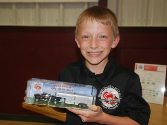 During Media Day June 5, young Farm Technology Days host farm family member Johnathan Sternweis showed off the commemorative farm toy for this year's show, slated for July 10-12 near Marshfield on his family's farm and that of their neighbor the Heiman family.