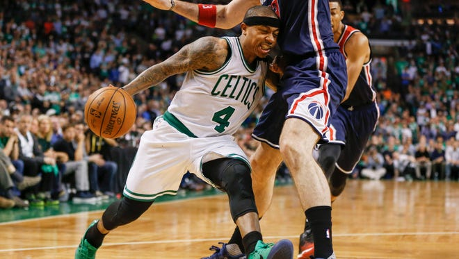 Boston Celtics point guard Isaiah Thomas (4) drives into Washington Wizards center Marcin Gortat (13) during the fourth quarter in Game 2.