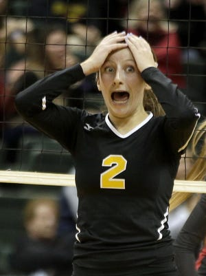 Fenwick's Graceann Gavigan reacts after a point during the Falcons' loss to Jonathan Alder in the semifinals of the state volleyball tournament Friday at Wright State.
