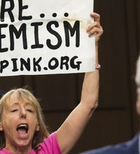 PHOTOS: Anti-war protesters disrupt Senate hearing