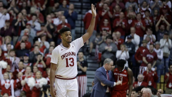Indiana forward Juwan Morgan (13) waves to the fans after being taken out of the second half of an NCAA college basketball game against Rutgers, Sunday, March 10, 2019, in Bloomington, Ind. (AP Photo/Darron Cummings)