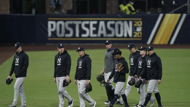 Yankees pitchers leave the field Friday night after the team's 2-1 loss to the Tampa Bay Rays in Game 5 of the A.L. Division Series.
