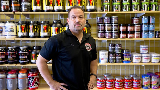 Frank Trumbetti, owner of Rock Bottom Nutrition and Fitness Center, stands Thursday at his store in Cherry Hill, New Jersey.