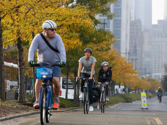 Cyclists ride along the reopened West Side bike path on Thursday in New York.