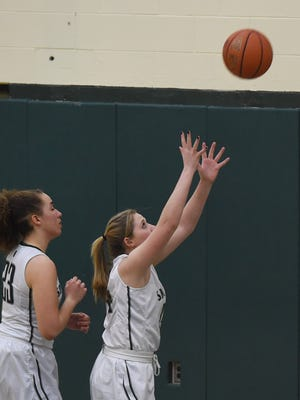 Spackenkill's Eileen Fiore, right, goes to catch a rebound during Friday's game against Webutuck.