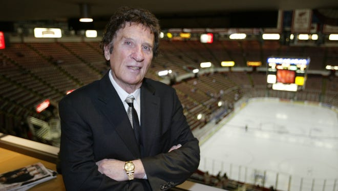 Red Wings owner Mike Ilitch talks to a Free Press reporter Oct. 24, 2003 in his suite prior to the start of the Red Wings and Dallas Stars game at Joe Louis Arena.