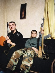 Years before the 2014 Winter Olympic Games in Sochi, Russia, a photographer and writer set out to tell the truth about the surrounding region before it was glossed over for the games. In this image from The Sochi Project, brothers Zashrikwa, 17, and Edrese, 14, pose on the sofa in their aunt and uncle's house in the Kodori Valley, a remote region on the border between Abkhazia and Georgia. The Sochi Project will be at the University of Cincinnati DAAP Galleries from Aug. 31 to Oct. 19.