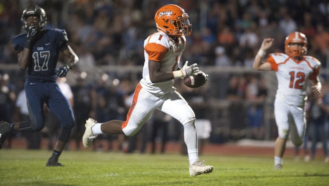 Cherokee'€™s Jamar Dimanche runs the ball in for a touchdown during the 2nd quarter of Friday nights football game between Cherokee and Timber Creek played at Timber Creek High School.  09.15.17