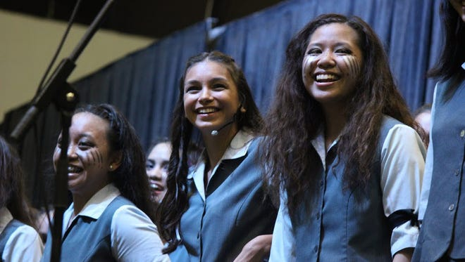 In this file photo, Jade Terlaje, Cristina Terlaje, and Aolani Permalino of the choir open up The Academy of Our Lady's Songfest in 2015.
