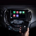 Apple's CarPlay home screen will be familiar to any iPhone user, with its app icons and round home button.