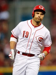 Cincinnati Reds first baseman Joey Votto (19) runs the bases after hitting a home run.