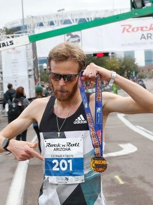Jeffrey Eggleston wins the Rock N' Roll Half Marathon on January 15, 2017 in Tempe, Ariz.
