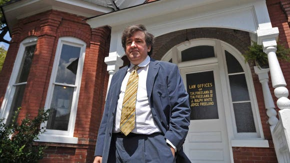 In this 2008 file photo, wOxford Lawyer Tom Freeland of Freeland & Freeland stands in front of his law office on the Square.