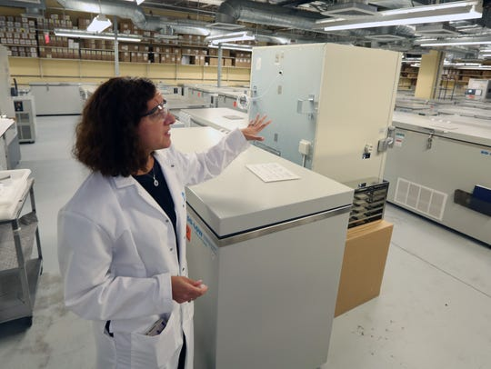Adriana Cahill in the freezer room at the Pfizer Vaccine