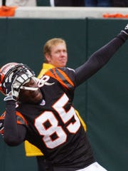 The Bengals' Chad Johnson takes off his helmet while celebrating a touchdown against the Seahawks in October of 2003.