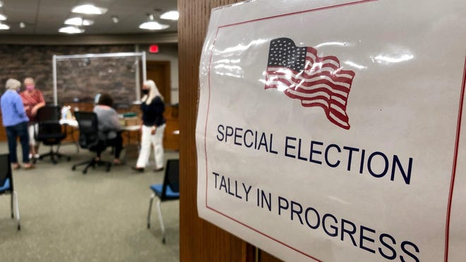 Workers count mail-in ballots submitted for a special election Wednesday, Aug. 27, at Holland City Hall. The special election was held after millage proposals were mistakenly left off primary ballots for Holland voters in Allegan County.