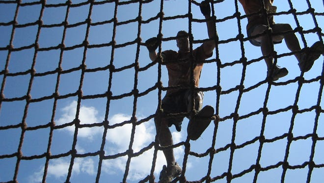 Annette Melillo, top right, of North Plainfield, negotiates her way on the cargo net during last year's Warrior Run. Obstacle course events come in all shapes and sizes to suit everyone from the weekend warrior to the fitness fanatic.