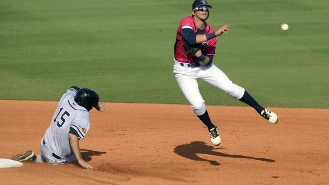 Blue Wahoos' Juan Perez goes for the double play Sunday against the Jacksonville Suns at Pensacola Bayfront Stadium.