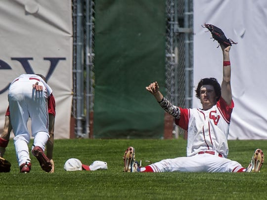 CVU's Jack Dugan, right, shows that he made the catch despite colliding with Deagan Poland, left, against Rice during the Division I state high school baseball championship at Centennial Field in Burlington on Saturday, June 13, 2015.
