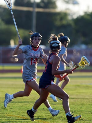 Vero Beach's Gracie Martin (14) scored three of her game-high four goals in the first half of the Fighting Indians' 15-6 regional semifinal win against Benjamin on Monday, April 30, 2018 at the Citrus Bowl.