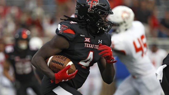 Texas Tech running back SaRodorick Thompson (4) followed up a 118-yard rushing performance against Houston Baptist with a 104-yard game Saturday against Texas. He's the first Tech back to start a season with consecutive 100-yard games on the ground since Ricky Williams in 1998.
