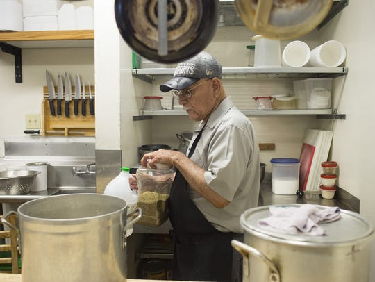 Frank Perez prepares for the lunch rush at Pobre Pancho's