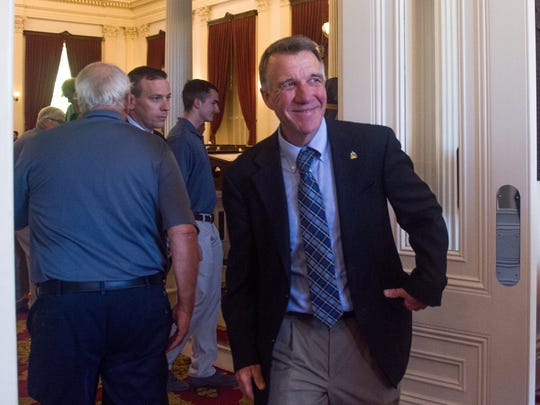 Gov. Phil Scott exits the chamber of the House of Representatives on Thursday, June 21 after giving a speech at the Green Mountain Boys' State program.