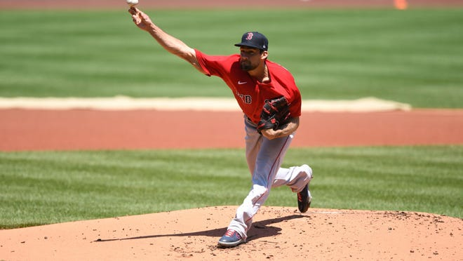 """Red Sox starter Nathan Eovaldi throws a pitch during practice at Fenway Park on Saturday. """"I feel great right now. I don't have any issues whatsoever,"""" he said, after the workout."""