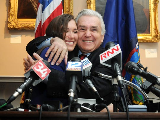 U.S. Rep. Maurice Hinchey gets a hug from his daughter, Michelle, during a meeting where he announced that he will not seek another term in Congress. The announcement was made in Kingston on Thursday, Jan. 19, 2012.