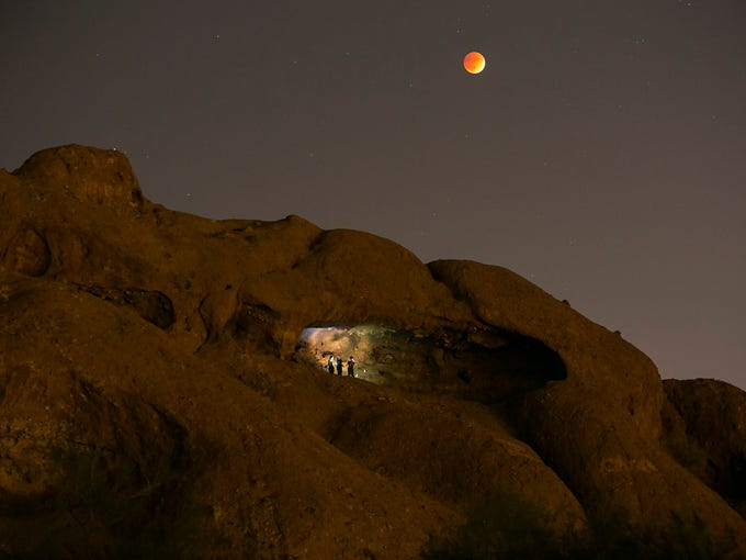 A bloodmoon hangs over the Hole in the Rock Sunday