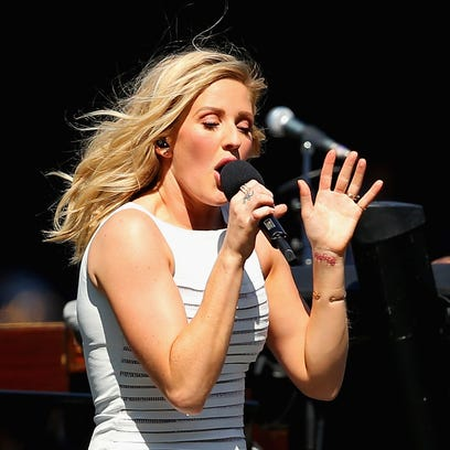 Ellie Goulding defended herself on Twitter after it appeared she was lip-syncing at an Australian Football League game Saturday.
