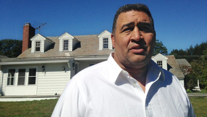 Former NFL lineman Brian Holloway in front of his home that was trashed during a Labor Day weekend party while he was away.